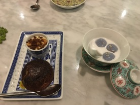 (Western) chocolate cake next to a loca dessert of glutunous rice with coconut